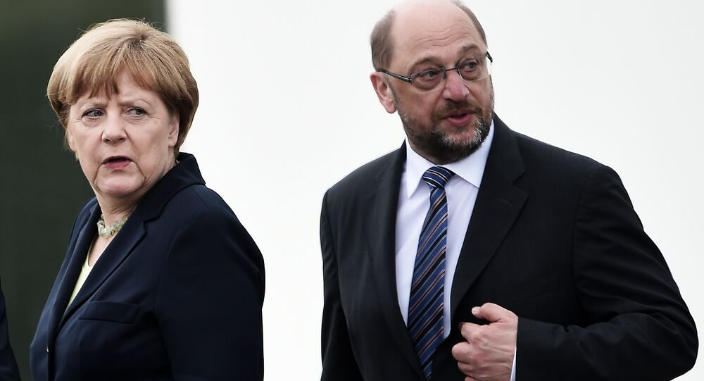 This file photo taken on May 29, 2016 shows German Chancellor Angela Merkel (L) and the President of the European Parliament Martin Schulz during a remembrance ceremony to mark the centenary of the battle of Verdun, at the Douaumont Ossuary (Ossuaire de Douaumont), northeastern France.