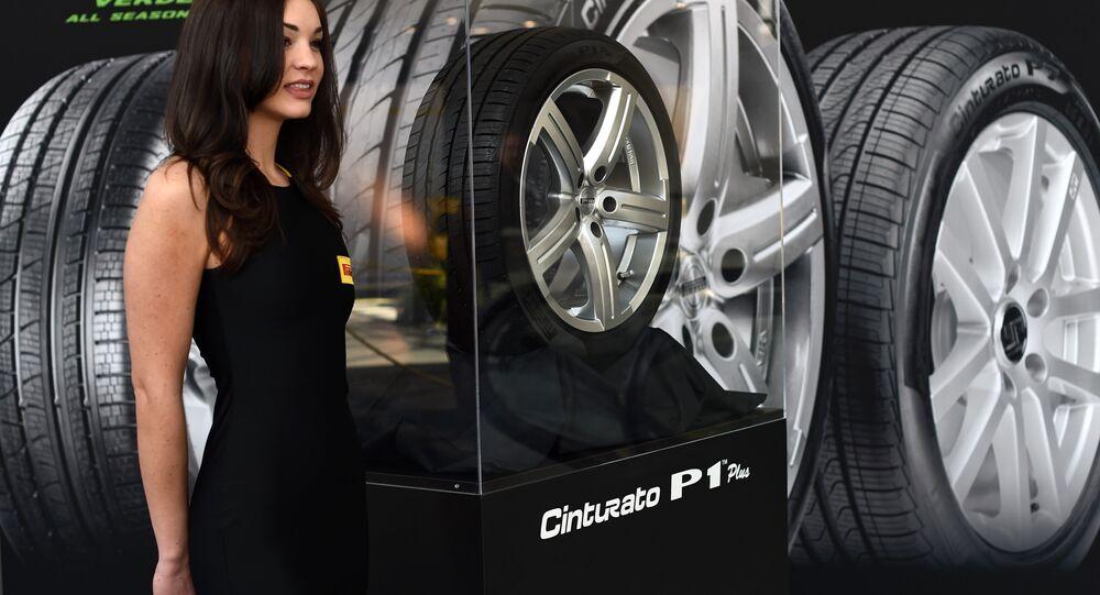 A model shows off the Pirelli Cinturato P1 plus tires