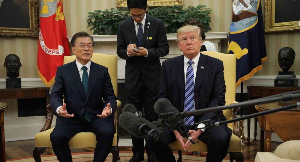 U.S. President Donald Trump (R) meets with South Korean President Moon Jae-in in the White House Oval Office in Washington, U.S., June 30, 2017
