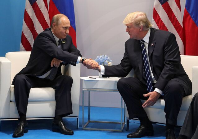 Russian President Vladimir Putin and President of the USA Donald Trump, right, talk during their meeting on the sidelines of the G20 summit in Hamburg