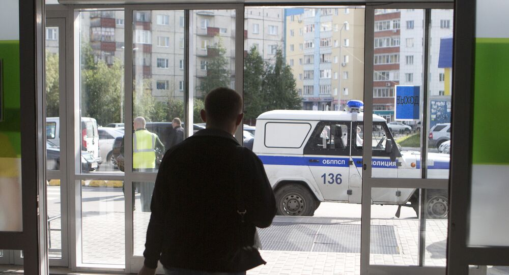 Police work in the center of Surgut on the site of a knife attack by an unidentified man who wounded eight people.