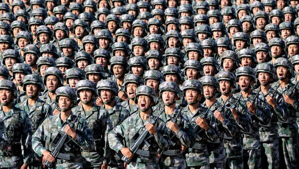 Soldiers of China's People's Liberation Army (PLA) get ready for the military parade to commemorate the 90th anniversary of the foundation of the army at Zhurihe military training base in Inner Mongolia Autonomous Region, China, July 30, 2017 - Sputnik Türkiye