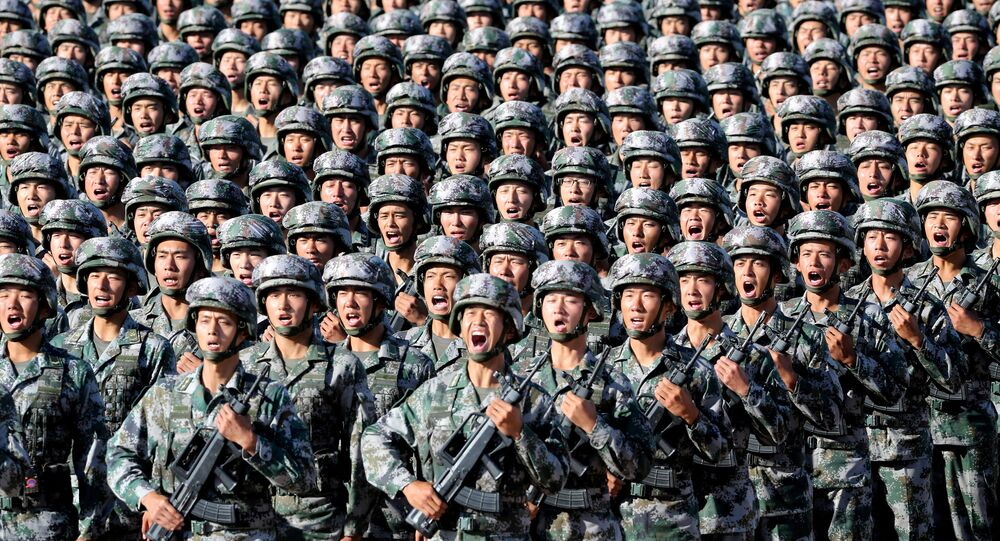 Soldiers of China's People's Liberation Army (PLA) get ready for the military parade to commemorate the 90th anniversary of the foundation of the army at Zhurihe military training base in Inner Mongolia Autonomous Region, China, July 30, 2017