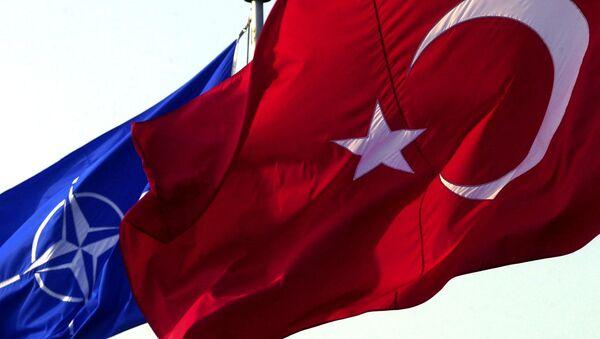 A Turkish flag waves in front of NATO's one - Sputnik Türkiye
