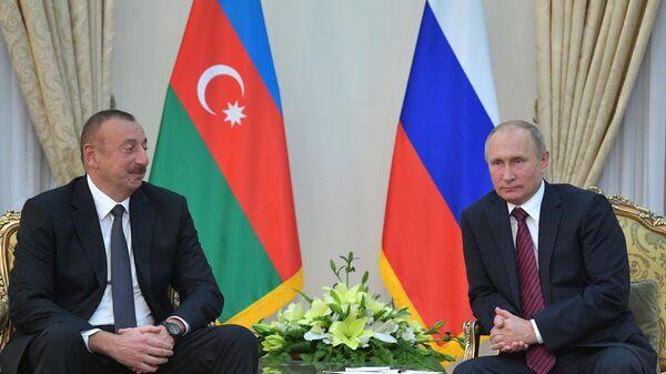 Azerbaycan Cumhurbaşkanı İlham Aliyev ve Rusya Devlet Başkanı Vladimir Putin - Sputnik Türkiye