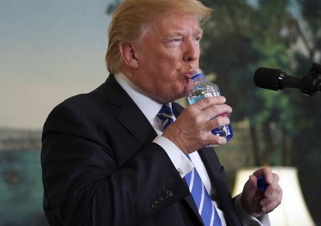 President Donald Trump pauses to drink water as he speaks in the Diplomatic Reception Room of the White House, Wednesday, Nov. 15, 2017 in Washington