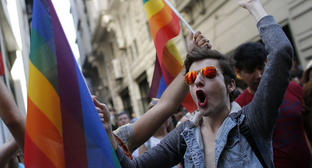 In this Sunday, June 28, 2015 file photo, participants of a Pride Week event in Istanbul, chant slogans after police used a water canon to disperse them.