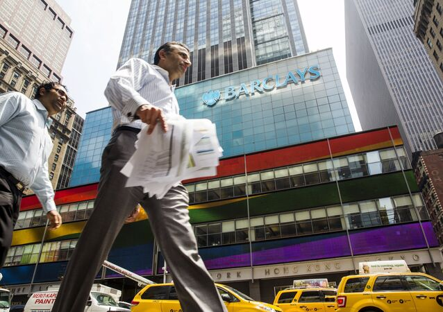 Pedestrians walk past a Barclays building as the LGBT rainbow flag is displayed on its digital screens in New York, June 26, 2015