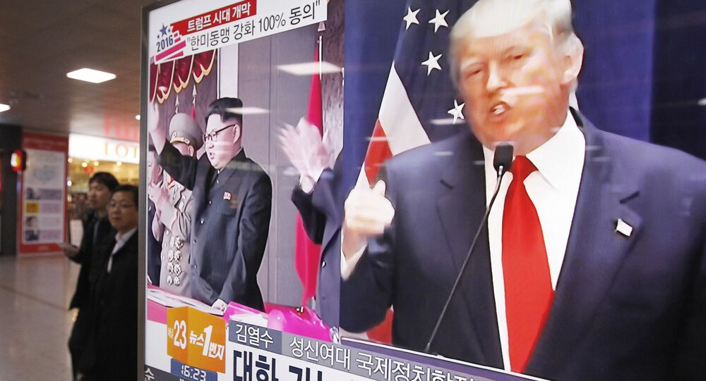 In this Nov. 10, 2016 file photo, a TV screen shows pictures of U.S. President-elect Donald Trump, right, and North Korean leader Kim Jong Un, at the Seoul Railway Station in Seoul, South Korea