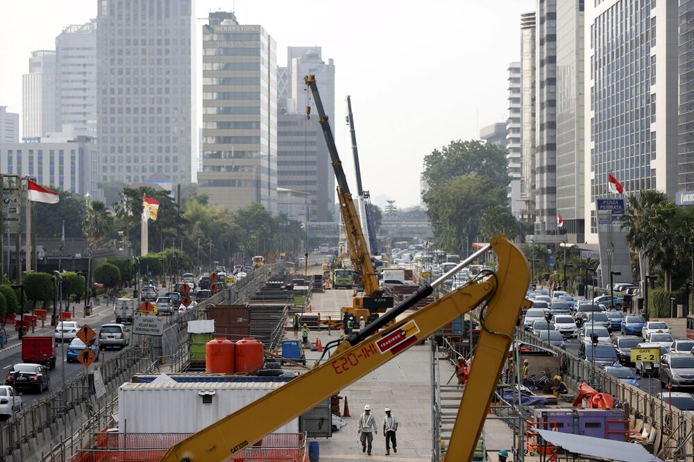 Workers using heavy machinery are seen constructing the new MRT line in central Jakarta, Indonesia July 2, 2015