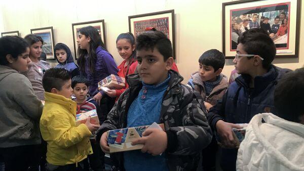 Rusya'nın Şam'daki Bilim ve Kültür Merkezi, Suriyeli çocuklar için Şam'da yılbaşı etkinlikleri düzenledi - Sputnik Türkiye