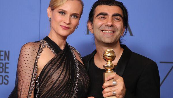 Fatih Akın'ın Almanya/Fransa ortak yapımı filmi In The Fade, Yabancı Dilde En İyi Film ödülü aldı. Fatih Akın ödülü, In The Fade'de rol alan Diane Kruger ile aldı. - Sputnik Türkiye
