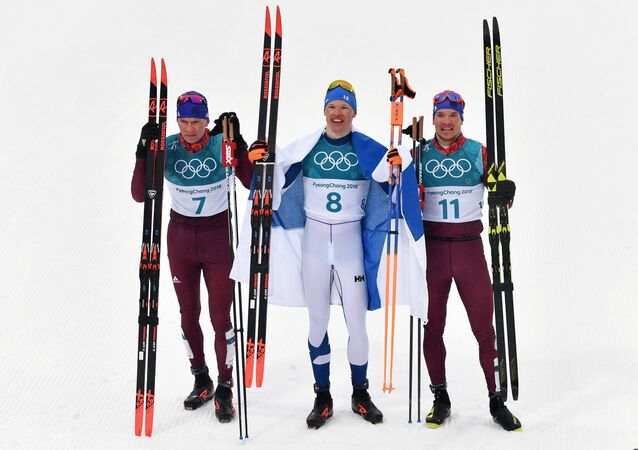 Medalists in the 50-km mass start race in men's cross-country skiing at the XXIII Olympic Winter Games in Pyeongchang, from left: Alexander Bolshunov (Russia) - silver medal; Iivo Niskanen (Finland) - gold medal; and Andrei Larkov (Russia) - bronze medal