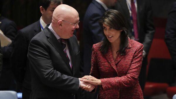 Russian Ambassador to the United Nations Vasily Nebenzya, left, and United States Ambassador to the U.N. Nikki Haley shake hands before a Security Council meeting, Tuesday, April 10, 2018, at U.N. headquarters - Sputnik Türkiye