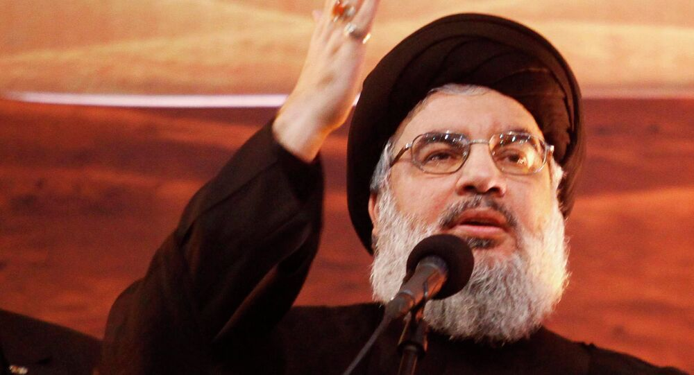 Lebanon's Hezbollah leader Sayyed Hassan Nasrallah addresses his supporters during a rare public appearance at an Ashoura ceremony in Beirut's southern suburbs November 3, 2014