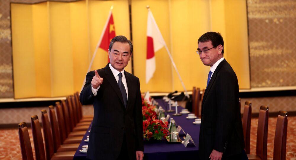 Japonya Dışişleri Bakanı Taro Kono ve Çin Dışişleri Bakanı Wang Yi