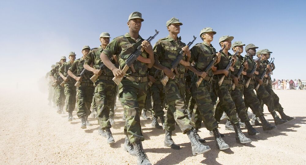 Polisario Front soldiers raise dust in their wake during a military parade in the Western Sahara village of Tifariti, file photo.