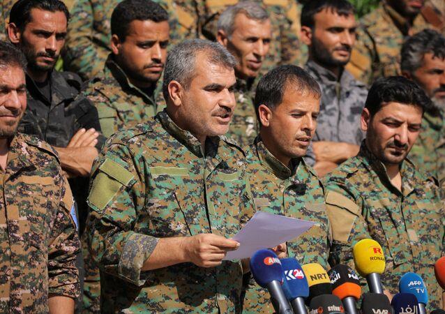 Menbiç Askeri Meclisi Sözcüsü Şarfan Derviş, basın toplantısında