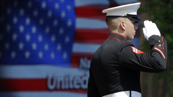 An officer of the US Marine Corps Color Guard stands at attention during the flag raising ceremony at the official opening of the National Day USA, at the Expo 2015 world's fair in Rho, near Milan, Italy, Saturday, July 4, 2015. - Sputnik Türkiye