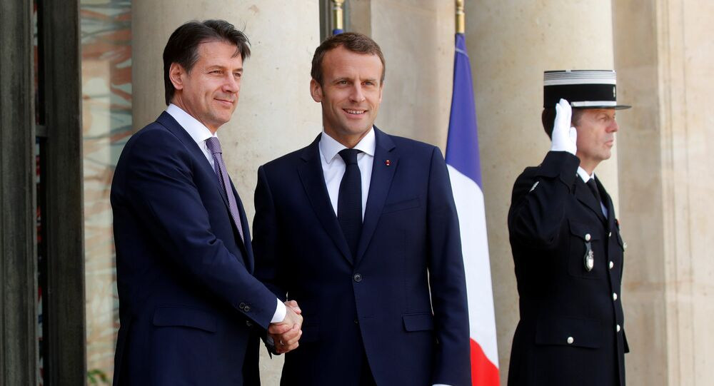 French President Emmanuel Macron welcomes Italian Prime Minister Giuseppe Conte as he arrives for a meeting at the Elysee Palace in Paris, France, June 15, 2018