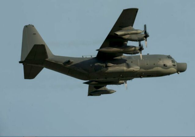 A U.S. Air Force MC-130H Combat Talon II from the 1st Special Operations Squadron flies over Kadena Air Base, Japan, shortly after takeoff May 14, 2015.