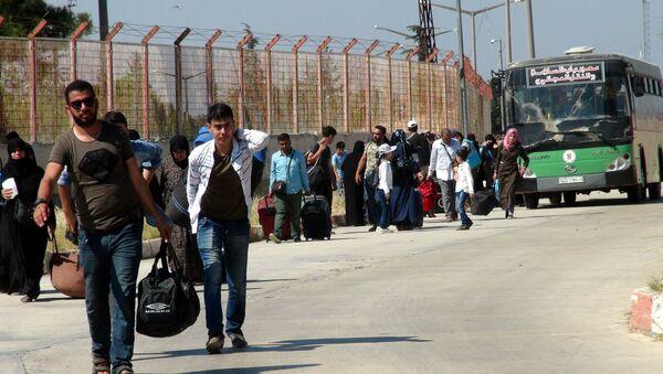 Bayram ziyaretine giden 30 bini aşkın Suriyeli döndü - Sputnik Türkiye