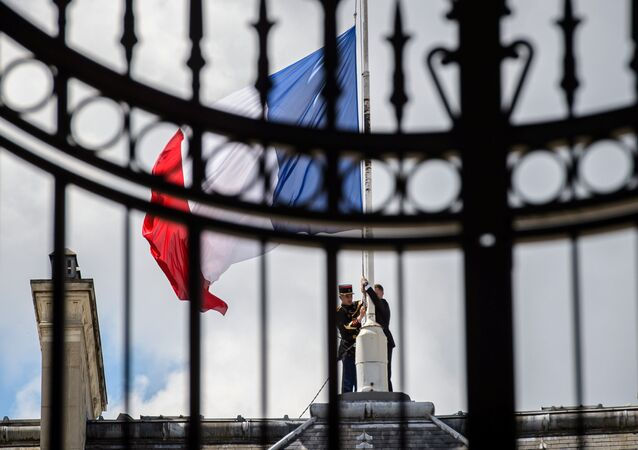 A Republican Guard lowers the French national flag at half-mast at the Elysee Palace in Paris, France, July 15, 2016, the day after the Bastille Day truck attack in Nice.