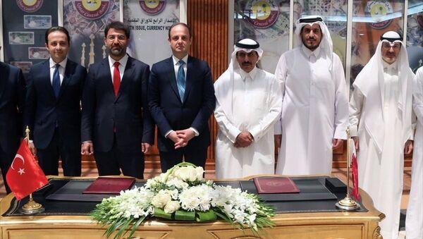 Türkiye Cumhuriyet Merkez Bankası ile Katar Merkez Bankası arasında Doha'da düzenlenen törenle ikili Para Takası (Swap) Anlaşması imzalandı. - Sputnik Türkiye