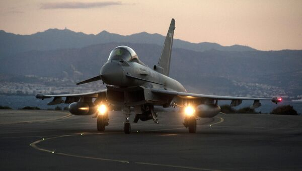 A British Royal Air Force Eurofighter Typhoon fighter jet is seen on the tarmac at the British airbase at Akrotiri, near Cyprus' second city of Limassol on December 3, 2015 - Sputnik Türkiye