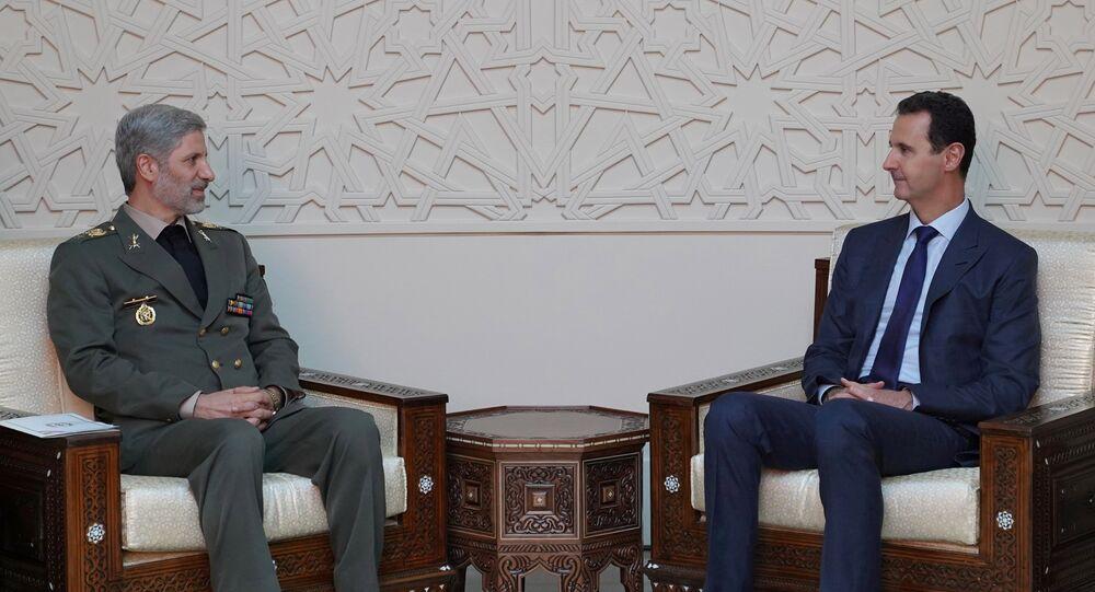 İran Savunma Bakanı Emir Hatemi ve Suriye Devlet Başkanı Beşar Esad