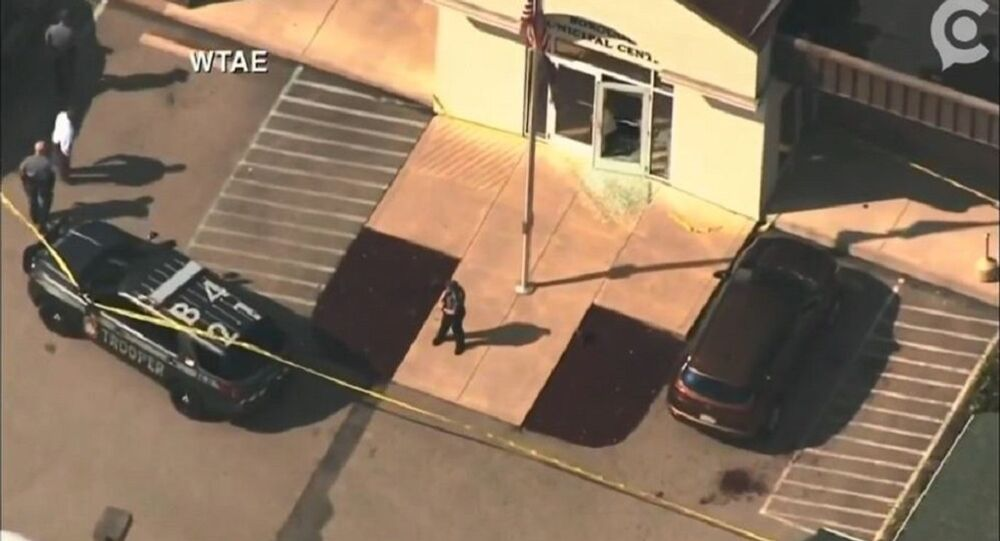 Officers respond to a shooting at a Fayette County district judge's office in Masontown, PA, September 19, 2018.