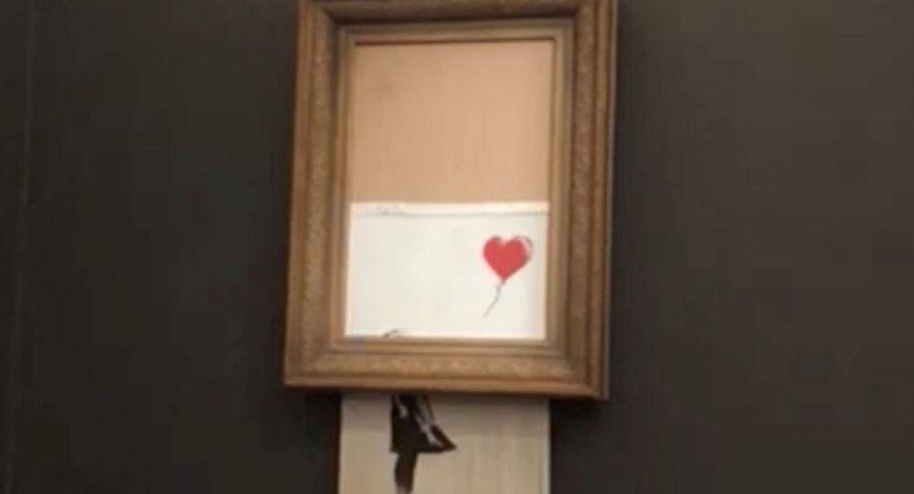 Banksy'nin kendi kendini imha eden Balonlu Kız eseri