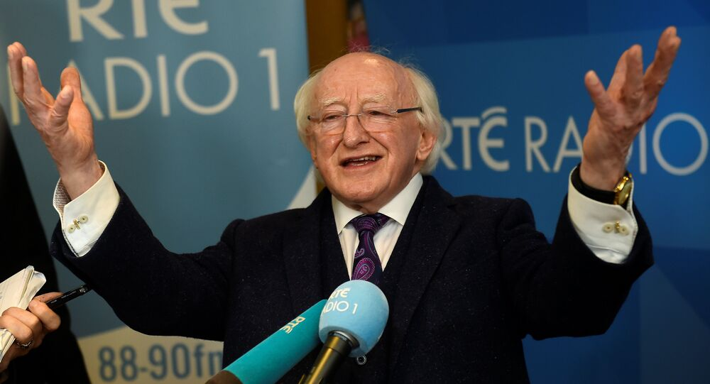 Ireland's presidential candidate President Michael D. Higgins speaks to media after a presidential debate on RTÉ Radio 1 in Dublin