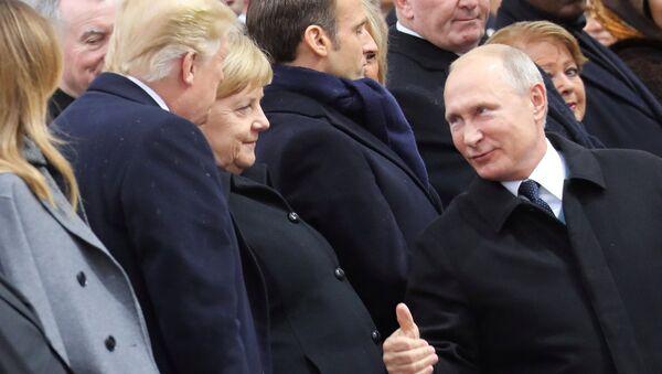 Putin, Paris'te Trump'la kısa bir görüşme yaptığını doğruladı - Sputnik Türkiye
