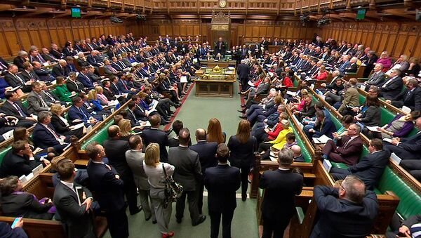 Britain's Prime Minister Theresa May addresses the House of Commons on her government's reaction to the poisoning of former Russian intelligence officer Sergei Skripal and his daughter Yulia in Salisbury, in London, March 14, 2018 - Sputnik Türkiye