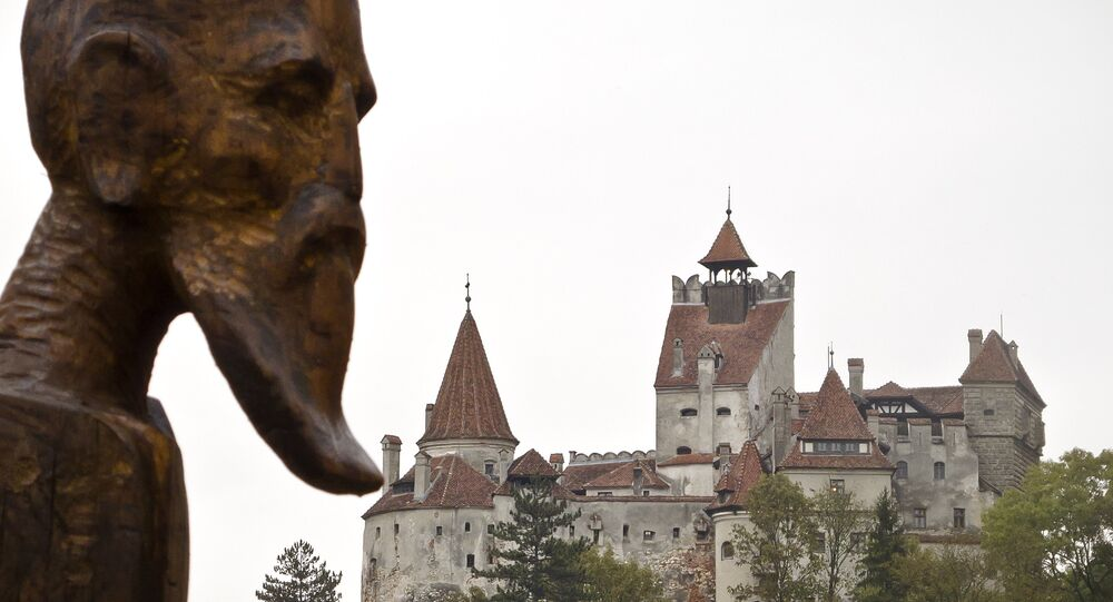 A sculpture commemorating Petru Darascu, a Romanian priest who survived several Communist prisons, by Ovidiu Nicolae Popa is backdropped by the Gothic Bran Castle, better known as Dracula Castle, in Bran, in Romania's central Transylvania region, Saturday, Oct. 8, 2011
