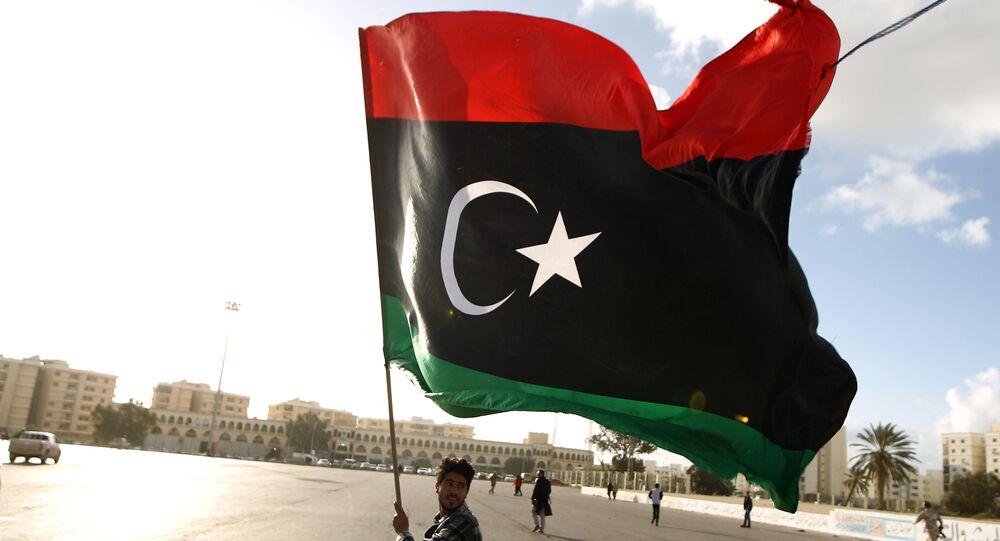 A Libyan man waves a national flag
