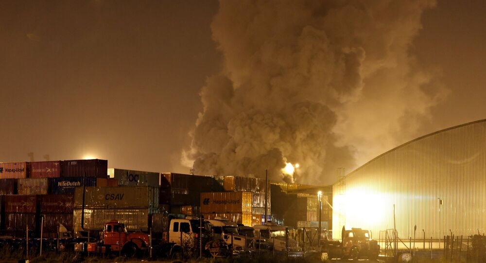 Smoke rises from chemical containers from logistic company Localfrio in Guaruja, Brazil, January 14, 2016