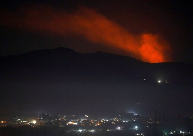 Smoke rises past a mountain as seen from Damascus countryside, Syria December 25, 2018