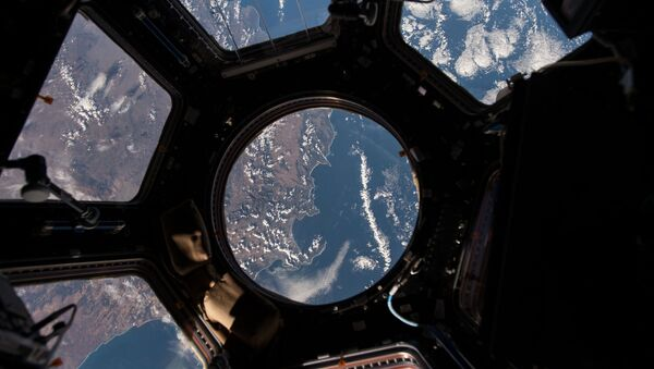 NASA astronaut Scott Kelly on the International Space Station took this Earth observation photo in the stations cupola that provides a 360 degree view. He tweeted this image with the comment: The view out my window.  - Sputnik Türkiye