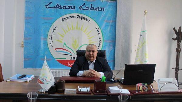 PYD'nin tek taraflı ilan ettiği ancak henüz kimsenin tanımadığı Cezire Kantonu'nun Yasama Meclisi Eş Başkanı Hakem Xalo - Sputnik Türkiye