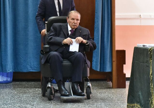 (FILES) In this file photo taken on May 04, 2017 Algerian President Abdelaziz Bouteflika is seen on a wheelchair as he votes at a polling station in Algiers.