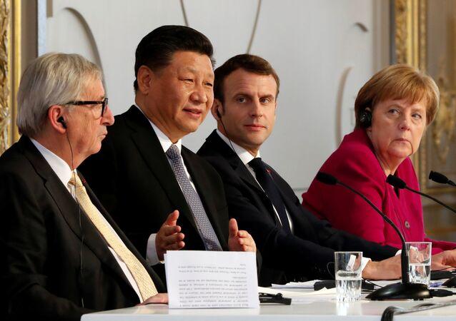 Emmanuel Macron, Şi Cinping, Angela Merkel ve Jean-Claude Juncker, Paris'te Elysee Sarayı'nda ortak basın toplantısında (26 Mart 2019)