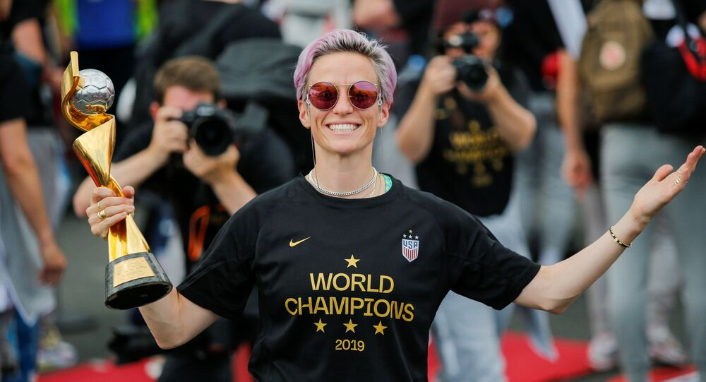 Megan Rapinoe smiles as she holds the Trophy for the FIFA Women's World Cup while the U.S. team arrive at the Newark International Airport, in Newark, New Jersey, U.S., July 8, 2019. REUTERS/Eduardo Munoz