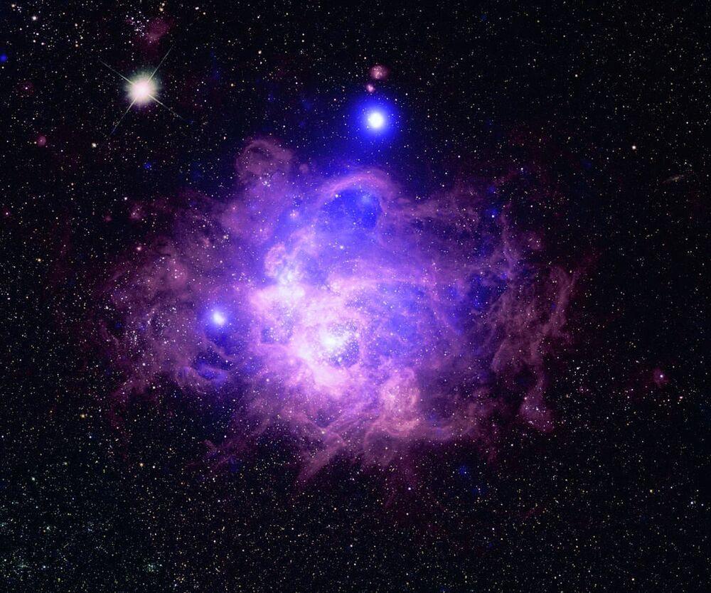 Üçgen Galaksisi'nde yer alan NGC 604 yıldız kümesi görüntüsü.