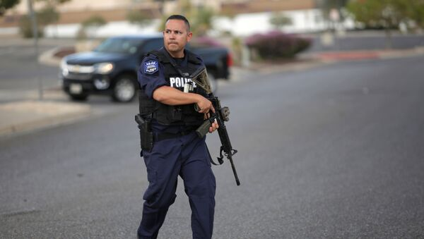A police officer is seen after a mass shooting at a Walmart in El Paso, Texas, U.S. August 3, 2019. - Sputnik Türkiye