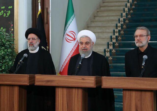 Ruhani, Meclis Başkanı Ali Laricani ve Yargı Erki Başkanı İbrahim Reisi