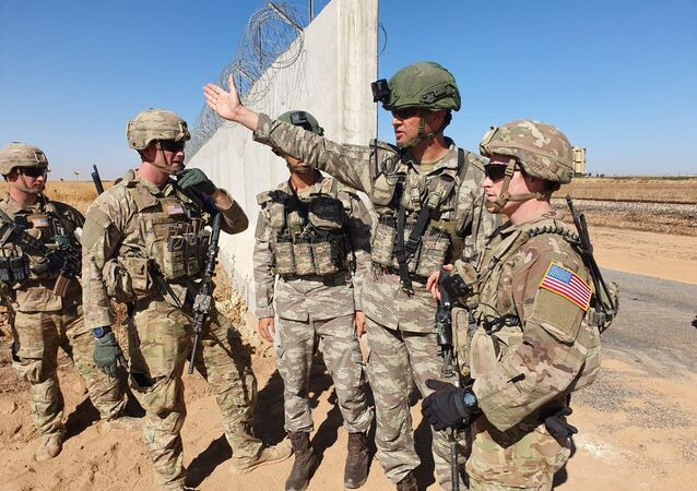 Turkish and U.S. soldiers meet on the Turkish-Syrian border for a joint U.S.-Turkey patrol, near the Turkish town of Akcakale