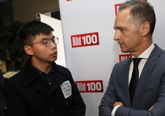 Bild 100 yaz partisinde Joshua Wong ile Heiko Maas arasındaki ayaküstü görüşme gayriresmi nitelikteydi.