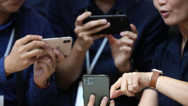Apple, iPhone 11 modellerini tanıttı - Sputnik Türkiye